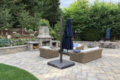 2018-Patio-with-Fireplace-and-Sitting-Wall-by-Aguiar-Pavers