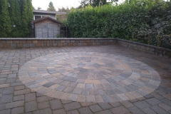 2018-Paver-Patio-with-circle-design-and-Sitting-Wall-by-Aguiar-Pavers