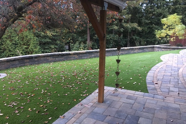Artificial Grass, Retaining Wall And Paving Stone Patio